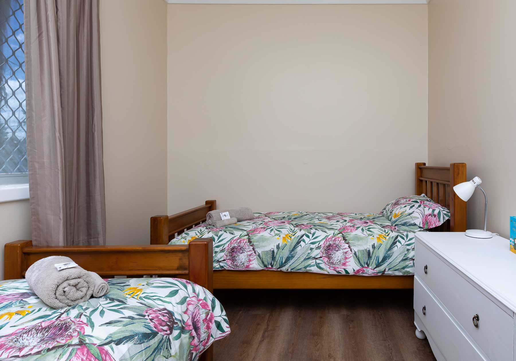 This Twin Room has two sturdy single beds with inner-spring mattresses, suitable for either children or adults.